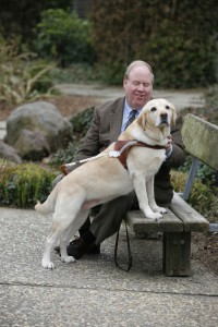 Picture of Michael Hingson with his guide dog